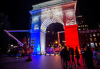 New York, NY - 14 November 2015 NYC  The arch in Washington Square Park lit up in blue, white and red, and a candlelight vigil to commemorate the victims of the 13 November Paris terror attacks.