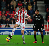 2nd December 2017, bet365 Stadium, Stoke-on-Trent, England; EPL Premier League football, Stoke City versus Swansea City; Peter Crouch of Stoke City wins the ball from Martin Olsson of Swansea City