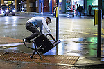 © Joel Goodman - 07973 332324 . 21/12/2013 . Manchester , UK . A man rides an office chair across the road and falls forwards off it when it hits a curb . Christmas revellers out in the rain in Manchester on Mad Friday , the last Friday night before Christmas which is typically one of the busiest nights of the year for police and ambulance crews . Photo credit : Joel Goodman