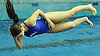 Sam Sanger of Port Washington soars through the air during the Nassau County girls' diving championship and state qualifier at Nassau Aquatic Center on Wednesday, November 4, 2015.<br /> <br /> James Escher