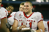 January 5th, 2008:  Rutgers lineman Ryan Blaszczyk (61) holds the MVP award after the International Bowl at the Rogers Centre in Toronto, Ontario Canada...Rutgers defeated Ball State 52-30.  ..Photo By:  Mike Janes Photography