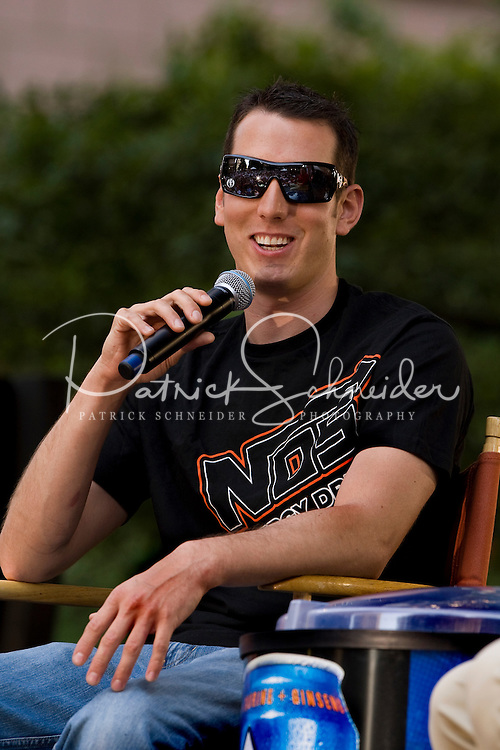 NASCAR driver Kyle Busch answers questions during Food Lion Speed Street in uptown Charlotte, NC.