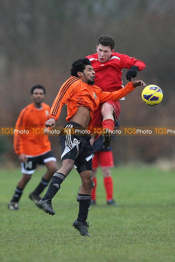Red Devils (orange) vs Angel & Crown - Hackney & Leyton Sunday League Dickie Davies Cup Football at South Marsh, Hackney Marshes, London - 10/02/13 - MANDATORY CREDIT: Gavin Ellis/TGSPHOTO - Self billing applies where appropriate - 0845 094 6026 - contact@tgsphoto.co.uk - NO UNPAID USE.