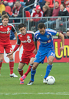 20 October 2012: Montreal Impact midfielder Davy Arnaud #22 and Toronto FC midfielder Eric Avila #8 in action during an MLS game between the Montreal Impact and Toronto FC at BMO Field in Toronto, Ontario Canada. ..