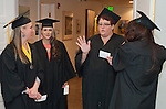 Shannon Ross, left, Shiloh Howell and Leah Clark talk before the Western Nevada College commencement in Fallon, Nev., on Tuesday, May 20, 2014. <br /> Photo by Kim Lamb