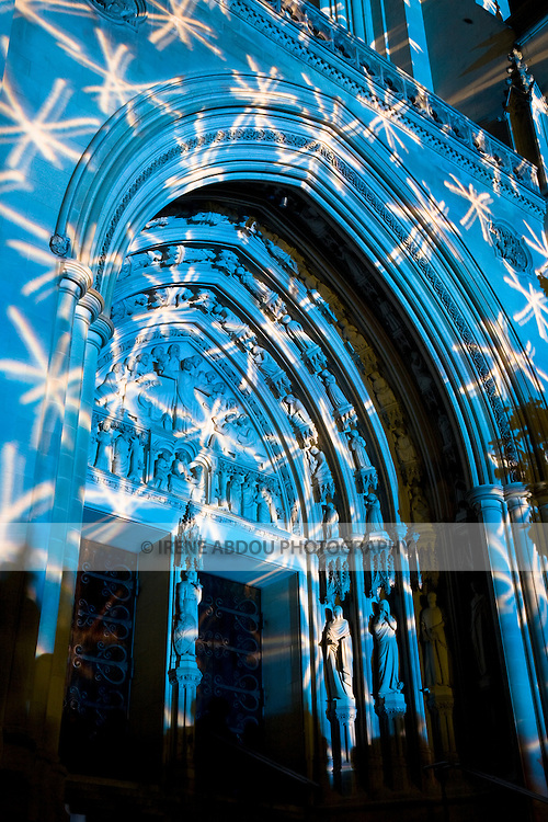 """The Washington National Cathedral's role as spiritual beacon for the nation is highlighted under the technical artistry of Gerry Hofstetter, Swiss lighting artist, during the Cathedral's centennial """"Lighting the Nation, Uniting the World"""" event."""