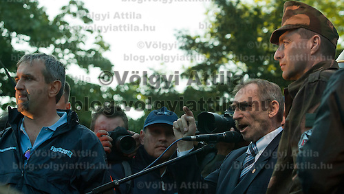 Sandor Pinter (2nd R) minister of internal affairs speaks on the stage during an anti-government rally of firemen and other law enforcement workers who protest in front of the Parliament against the government's austerity measures in Budapest, Hungary on May 06, 2011..The government has launched a package of fiscal reforms to cut the budget deficit, including scrapping early retirement, which mostly affects law enforcement personnel. ATTILA VOLGYI
