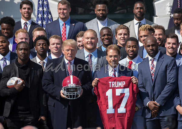United States President Donald J. Trump poses for photos with Coach Nick Saban and members of the 2017 NCAA Football National Champions: The Alabama Crimson Tide during their welcoming ceremony at the White House in Washington, DC, March 10, 2018. Photo Credit: Chris Kleponis/CNP/AdMedia