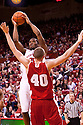 27 December 2011: Caleb Walker #25 of the Nebraska Cornhuskers shoots against Jared Berggren #40 of the Wisconsin Badgers during the first half at the Devaney Sports Center in Lincoln, Nebraska. Wisconsin defeated Nebraska 64 to 40.