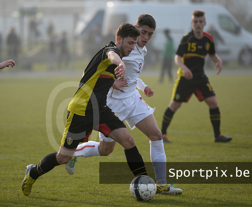 20140314 - HEIST , BELGIUM : Belgian Alper Ademoglu (8) pictured in a duel with Serbian Milan Panovic (r) during a friendly soccer match between the Under16 soccerteams of Belgium and Serbia , Friday 14 March 2014 in Heist . PHOTO DAVID CATRY