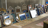 A collection of antique mirrors on sale at the original Brooklyn Flea in the neighborhood of Clinton Hill on Saturday, August 8, 2015. The flea market, which hosts over 100 booths by Brooklyn vendors offering handmade or used merchandise opens up in the athletic field of Bishop Loughlin High School on Saturdays. Shoppers come from all over the city for the bargains and one-of-a-kind local merchandise that is offered for sale.  (© Richard B. Levine)