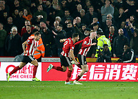 24th November 2019; Bramall Lane, Sheffield, Yorkshire, England; English Premier League Football, Sheffield United versus Manchester United; Oliver McBurnie of Sheffield United runs to celebrate as he scores in the 90th minute to make it 3-3 with George Baldock  of Sheffield United and John Lundstram  of Sheffield United chasing him the goal was given after a VAR decision - Strictly Editorial Use Only. No use with unauthorized audio, video, data, fixture lists, club/league logos or 'live' services. Online in-match use limited to 120 images, no video emulation. No use in betting, games or single club/league/player publications