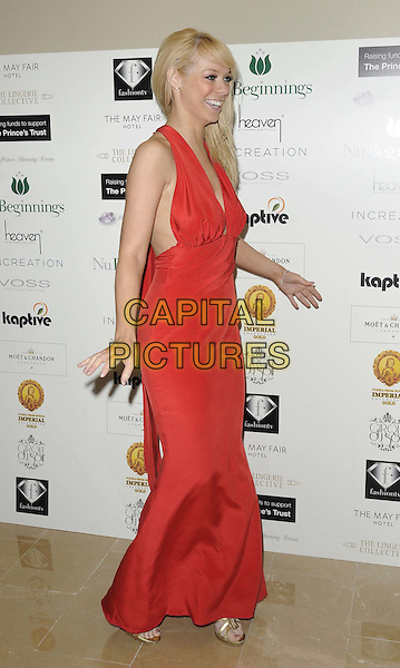 Liz McClarnon.The Prince Charming Valentines Ball, Mayfair hotel, Stratton St., London, England..February 14th, 2012.full length red dress side profile halterneck.CAP/CAN.©Can Nguyen/Capital Pictures.