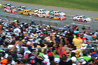 Oct 5, 2008; Talladega, AL, USA; NASCAR Sprint Cup Series driver Travis Kvapil (28) leads the field during the Amp Energy 500 at the Talladega Superspeedway. Mandatory Credit: Mark J. Rebilas-