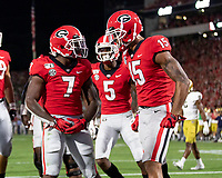ATHENS, GA - SEPTEMBER 21: D'Andre Swift #7 of the Georgia Bulldogs celebrates with teammate Lawrence Cager #15 after scoring a Georgia touchdown during a game between Notre Dame Fighting Irish and University of Georgia Bulldogs at Sanford Stadium on September 21, 2019 in Athens, Georgia.