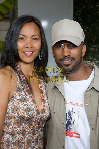 "TIM STORY & GUEST.At the ""Hustle & Flow"" Los Angeles Film Premiere,.held at the Arclight Cinerama Dome, .Hollywood, California, USA, 20th July 2005..portrait headshot cap hat.Ref: ADM.www.capitalpictures.com.sales@capitalpictures.com.©Zach Lipp/AdMedia/Capital Pictures."