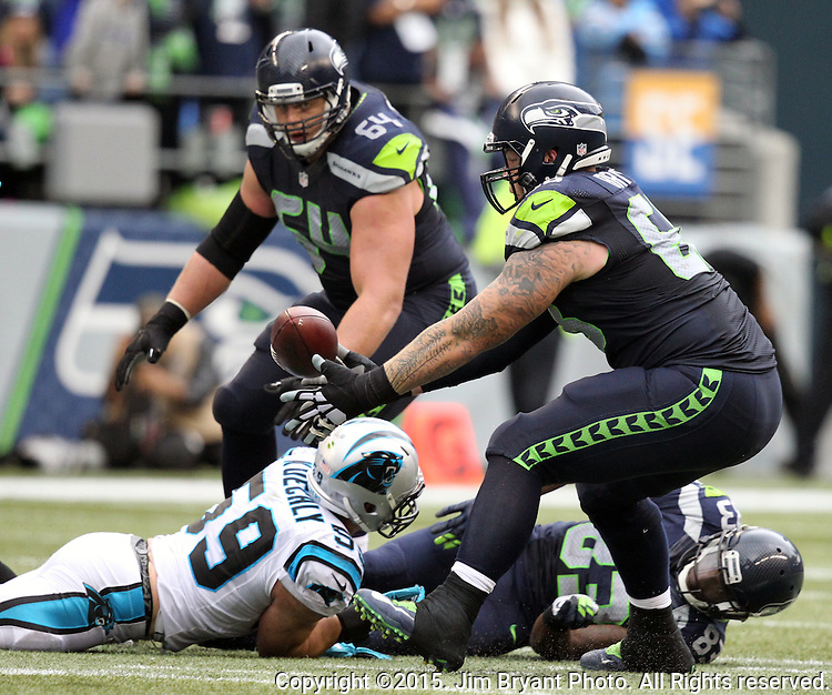 Seattle Seahawks  guard J.R. Sweezy and guard Justin Britt (64) watches the ball fumbled by wide receiver Richardo Lockette (83) after he was tackled by  Carolina Panthers linebacker Luke Kuechly (59) at CenturyLink Field in Seattle on October 18, 2015. The Panthers came from behind with 32 seconds remaining in the 4th Quarter to beat the Seahawks 27-23.  ©2015 Jim Bryant Photography. All Rights Reserved.