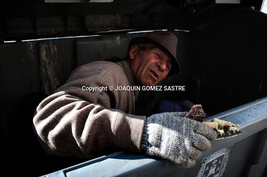 Jose de Albacete makes a living looking at trash bins in Alicante
