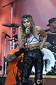 MILEY CYRUS - and Mark Ronson on guitar, rapper Lil Nas X and Billy Ray Cyrus -; performing live on the Pyramid Stage at the 2019 Glastonbury Festival Somerset UK - 30 Jun 2019.; Photo credit: Zaine Lewis/IconicPix/AtlasIcons.com