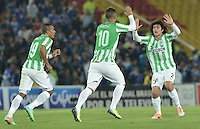 BOGOTÁ -COLOMBIA, 09-02-2014. Jugadores del Atlético Nacional celebran un gol en contra de Millonarios durante partido por la fecha 4 de la Liga Postobón  I 2014 jugado en el estadio Nemesio Camacho el Campín de la ciudad de Bogotá./ Atlético Nacional players celebrate a goal against Millonarios during match for the 4th date of the Postobon  League I 2014 played at Nemesio Camacho El Campin stadium in Bogotá city. Photo: VizzorImage/ Gabriel Aponte / Staff