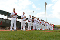 Ball State Cardinals head coach Rich Maloney (left) and assistant coach Scott French (12) stand with the team during the national anthem before a game against the Maine Black Bears on March 3, 2015 at North Charlotte Regional Park in Port Charlotte, Florida.  Ball State defeated Maine 8-7.  (Mike Janes/Four Seam Images)