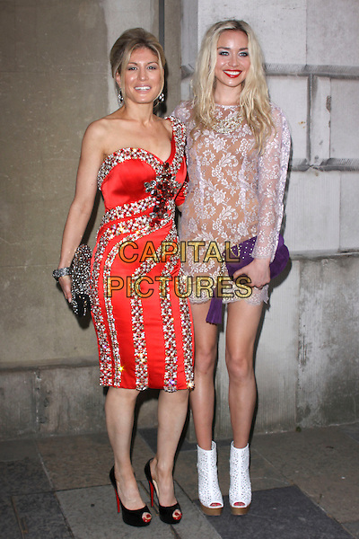HOFIT GOLAN & NOELLE RENO .attending the Women For Women Gala, Banqueting House, London, England, UK, May 5th 2011..full length purple lilac dress lace mini long sleeve clutch bag white ankle boots shoes cut out peep toe platform purple tassel red one sleeve shoulder beaded jewelled embellished jewel encrusted christian louboutin .CAP/AH.©Adam Houghton/Capital Pictures.