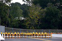 Sep 15, 2013; Charlotte, NC, USA; NHRA safety safari members line up for the national anthem prior to the Carolina Nationals at zMax Dragway. Mandatory Credit: Mark J. Rebilas-