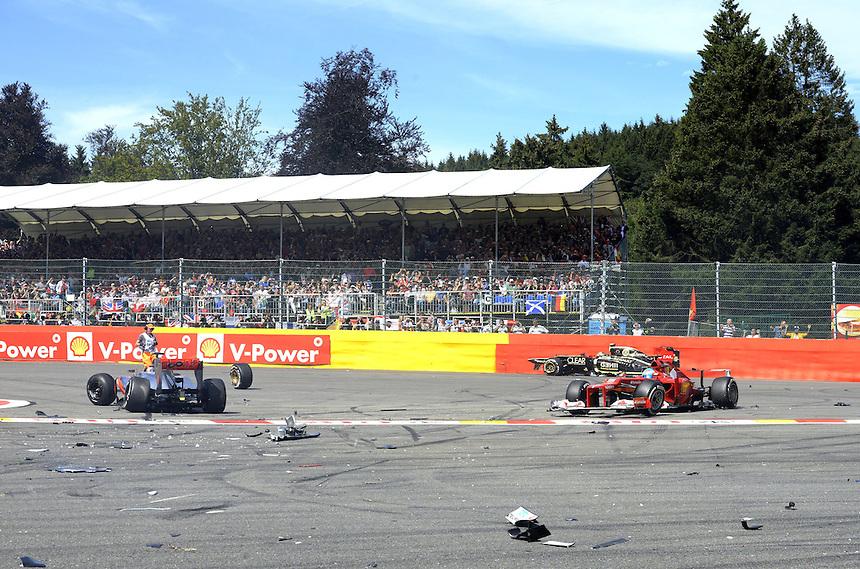 .Accidented Crash - Kimi Raikkonen (FIN), Lotus Renault F1 Team - Fernando Alonso (ESP),  Scuderia Ferrari ..2012 FIA Formula One World Championship - Belgian Formula One Grand Prix, Circuit Spa Francorchamps, Spa Francorchamps, Belgium. Sunday 2nd September 2012...
