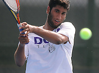 NWA Media/ J.T. Wampler - Fayetteville High School's Sameer Kamath returns a serve Thursday Oct. 9, 2014 during the 7A-West Conference boys tennis tournament at Springdale Har-Ber High School in Springdale.