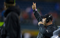 SEATTLE, WA - September 28, 2013: Stanford linebacker coach Lance Anderson gives a signal during play against Washington State at CenturyLink Field. Stanford won 55-17