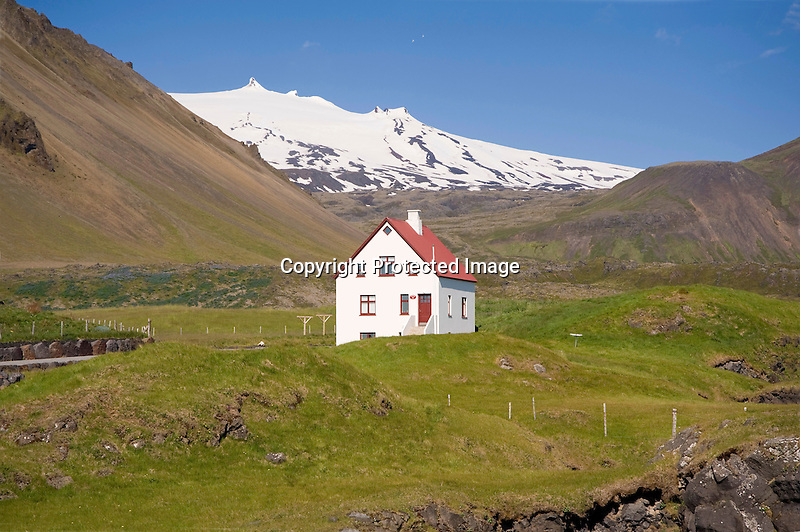 View of Snaefellsjokull Glacier and Home in Arnarstapi Village in West Iceland