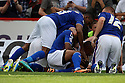 Jose Baxter of Oldham is mobbed by team-mates after scoring the winner<br />  Stevenage v Oldham Athletic - Sky Bet League 1 - Lamex Stadium, Stevenage - 3rd August, 2013<br />  © Kevin Coleman 2013
