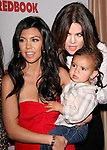 Khloe Kardashian Odom and Kourtney Kardashian and baby Mason at REDBOOK's first-ever family issue celebration featuring the Kardashians held at The Sunset Tower Hotel in West Hollywood, California on April 11,2011                                                                               © 2010 Hollywood Press Agency