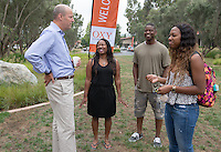 From left, Occidental College President Jonathan Veitch chats with Latoya Hollis, Fred Coleman and their daughter, Diamond Coleman '19, during Orientation, Aug. 21, 2015.<br />