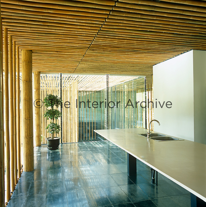 The kitchen has a long marble work surface and like the rest of the house is clad with bamboo