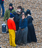 BNPS.co.uk (01202 558833)<br /> Pic: Graham Hunt/BNPS<br /> <br /> Kate Winslet and Saoirse Ronan during a break in filming on the Beach at Eype near Bridport in Dorset yesterday for the new film Ammonite about the life of fossil hunter Mary Anning.