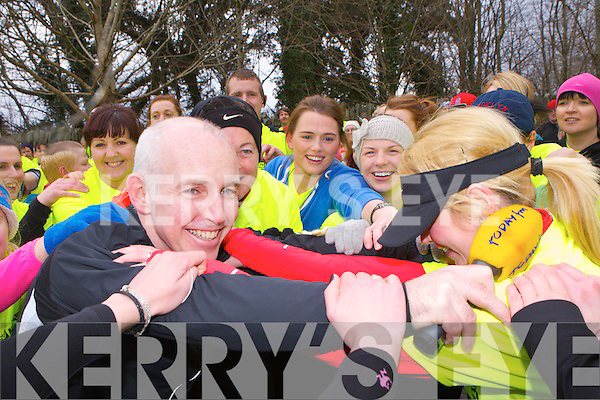 Ray Darcy stretching with the public before the 5k on Monday in Killarney