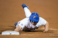 Deacon Liput (8) of the Florida Gators dives towards first base against the Wake Forest Demon Deacons in Game One of the Gainesville Super Regional of the 2017 College World Series at Alfred McKethan Stadium at Perry Field on June 10, 2017 in Gainesville, Florida.  The Gators defeated the Demon Deacons 2-1 in 11 innings.  (Brian Westerholt/Four Seam Images)