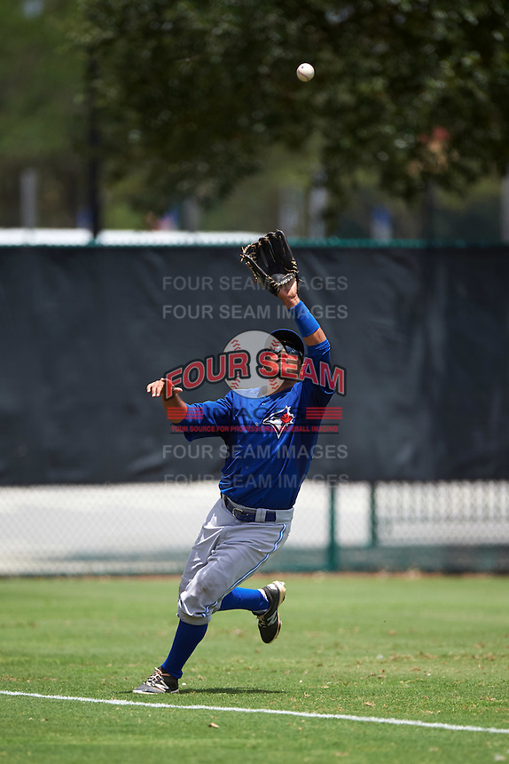 GCL Blue Jays left fielder Norberto Obeso (28) catches a fly ball during a game against the GCL Braves on August 5, 2016 at ESPN Wide World of Sports in Orlando, Florida.  GCL Braves defeated the GCL Blue Jays 9-0.  (Mike Janes/Four Seam Images)