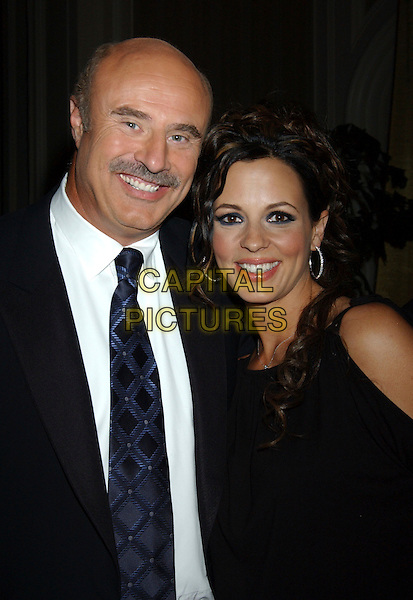 DR. PHIL McGRAW & SARA EVANS.Picture: Talk Show Host Dr. Phil McGraw and Sara Evans during the 39th Annual Academy of Country Music Awards RCA Label Group Post Party held at Mandalay Bay Resort and Casino, Las Vegas, USA, May 26th 2004..half length black dress.Sara Evans and her estranged husband Craig Schelske launch attacks and counter attacks. Yesterday, Evans accused Schelske of draining the couple's joint and business bank accounts of $275,000. Schelske says he is planning to vigorously defend himself against his wife's allegations of adultery and inappropriate conduct. Evans accused Schelske of having an affair with her best friend and children's nanny in her October 12th divorce petition. Evans, 35 and Schelske, 43, married in 1993 and have three children ranging in age from 2 to 7.  .Ref: ADM/LF.www.capitalpictures.com.sales@capitalpictures.com.©Laura Farr/AdMedia/Capital Pictures.