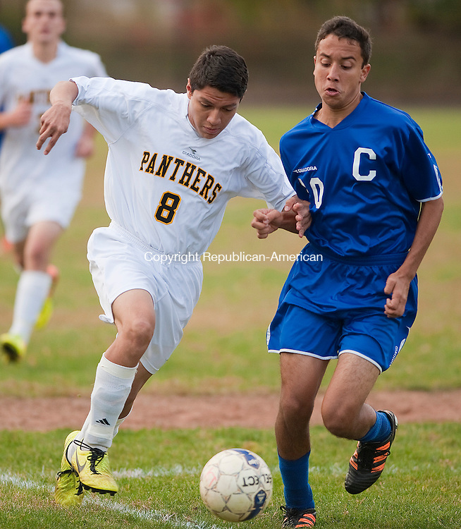 WATERBURY- 102313JS13- Kanor Tech's Rubin Martinez (8) and Crosby's Alex Perez (10) bump one another while running down the ball during their game Wednesday at Kaynor Tech High School in Waterbury.<br /> Jim Shannon Republican-American