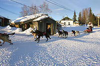 Ramy Brooks Team Runs Down Road Out of Nikolai Chkpt 2005 Iditarod