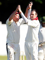 North Middx's Brad Sculley (L) high fives Darren Eckford after Eckford dismissed an Enfield player during the Middlesex County Cricket League Division Two game between North Middlesex and Enfield at Park Road, Crouch End, London on Sat May 22, 2010