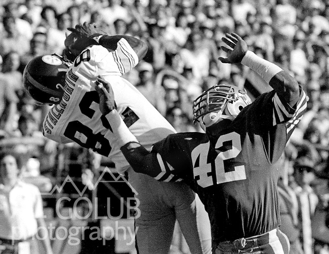 San Francisco 49ers vs. Pittsburgh Steelers at Candlestick Park Sunday, October 14, 1984..Steelers beat the 49ers 20-17.San Francisco 49ers Defensive Back Ronnie Lott (42) misses breaking up pass to Pittsburgh Steelers Wide Receiver John Stallworth (82)..