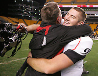 PITTSBURGH, PA - NOVEMBER 05:  Tom DeTemple #96 of the Cincinnati Bearcats hugs head coach Butch Jones following their win against the Pittsburgh Panthers on November 5, 2011 at Heinz Field in Pittsburgh, Pennsylvania.  (Photo by Jared Wickerham/Getty Images)