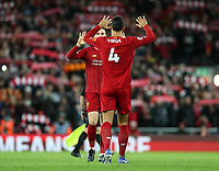2nd January 2020; Anfield, Liverpool, Merseyside, England; English Premier League Football, Liverpool versus Sheffield United; Jordan Henderson of Liverpool high fives Virgil van Dijk of Liverpool prior to the kick off  - Strictly Editorial Use Only. No use with unauthorized audio, video, data, fixture lists, club/league logos or 'live' services. Online in-match use limited to 120 images, no video emulation. No use in betting, games or single club/league/player publications