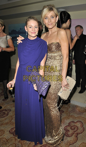Nicola Stapleton & Michelle Collins .The London Lifestyle Awards 2011, Park Plaza Riverbank hotel, Albert Embankment, London, England..October 6th, 2011.full length purple gold dress strapless brown print.CAP/CAN.©Can Nguyen/Capital Pictures.