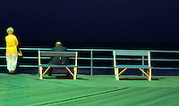 The Jersey Shore at Night - August 1981, Middle Aged Couple Watching the Atlantic Ocean at Night from the Boardwalk, Asbury Park, New Jersey, USA.<br /> <br /> Original Image Photographed in August 1981 on Kodak Ektachrome Tranparency Film.