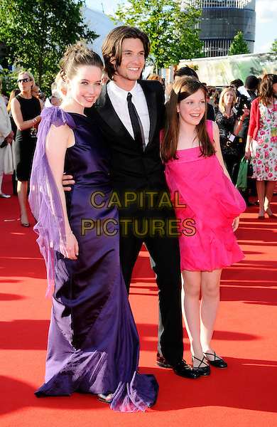 "ANNA POPPLEWELL, BEN BARNES & GEORGIE HENLEY.attending the European Premiere of ""The Chronicles Of Narnia: Prince Caspian"" at the O2 Arena, London, England, 19th June 2008. . arrivals full length pink purple dress black suit tie.CAP/CAN.©Can Nguyen/Capital Pictures"