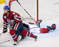 April 28, 2007; Hamilton, ON, CAN; Rochester Americans right winger (22) Greg Jacina trips Hamilton Bulldogs goalie (29) Carey Price from behind during the third period of game six in the AHL north division semifinal at Copps Coliseum. The Bulldogs won 6-2 and eliminated the Americans from the playoffs. Mandatory Credit: Ron Scheffler, Special to the Spectator. (File number RRSA8529).